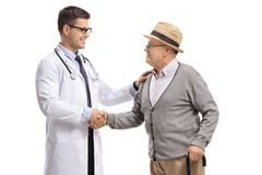Male doctor and a mature man shaking hands. Male doctor and a mature men shaking hands isolated on white background royalty free stock images