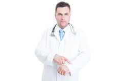 Male doctor or medic showing watch like being punctual concept. Isolated on white background with copy text space Stock Images