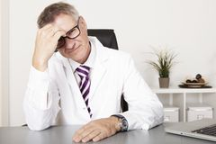 Male Doctor Not Feeling Well Royalty Free Stock Image