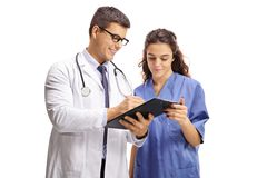 Male doctor and a nurse with clipboard royalty free stock photography
