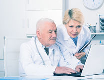 Male doctor and nurse Stock Images