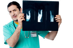 Male doctor observing x ray image royalty free stock photos