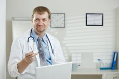 Male doctor in office royalty free stock photography