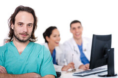Male Doctor On Focus, Two Doctors Discussing Stock Images