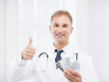 Male doctor with packs of pills Stock Photo