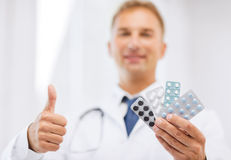 Male doctor with packs of pills Royalty Free Stock Images