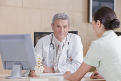 Male doctor and patient Stock Images