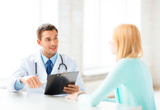 Male doctor with patient Stock Photography