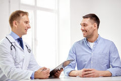Male doctor and patient with clipboard at hospital Stock Images