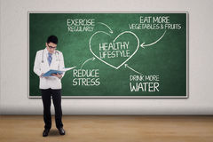 Male doctor and plan for healthy lifestyle Royalty Free Stock Photography