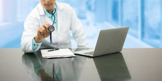 Male Doctor Working on Office Desk in Hospital Royalty Free Stock Images