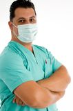 Male doctor posing with face mask Stock Photo
