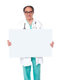 Male doctor posing with white blank billboard Royalty Free Stock Photo