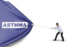 Male doctor pulling asthma banner Royalty Free Stock Photo