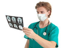 Male doctor reading tomography brain Royalty Free Stock Photo
