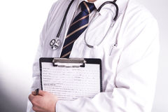 Male doctor ready to write patient information Royalty Free Stock Photography