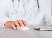 Male doctor's hand using computer Royalty Free Stock Images