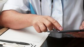 Male doctor`s hands using his modern digital tablet computer. stock video footage