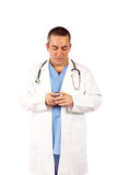 Male doctor sending sms Stock Photography