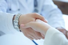Male doctor shaking hands with patient. Partnership, trust and medical ethics concept. Handshake with satisfied client. Thankful handclasp for excellent Stock Photography