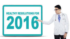 Male doctor show healthy resolutions for 2016 Royalty Free Stock Photography