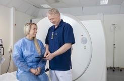 Male Doctor Showing Digital Tablet To Patient At MRI Machine Royalty Free Stock Photo