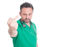 Male doctor showing obscene middle finger gesture Stock Photos