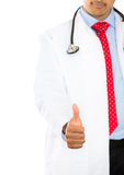 Male doctor showing thumbs-up Stock Images