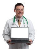 Male doctor smiling and holding a laptop computer Stock Photo
