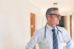 Male  doctor standing in corridor at retirement home royalty free stock photo