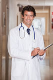 Male Doctor Standing with Folder Royalty Free Stock Photo