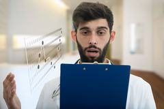 Male Doctor standing with folder, with shocked expression in hospital.  Stock Photography