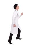 Male doctor stepping up isolated on white background Stock Images