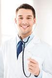 Male doctor with stethoscope Stock Images