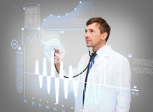 Male doctor with stethoscope and cardiogram Stock Image