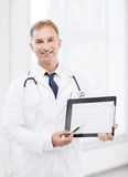 Male doctor with stethoscope showing cardiogram Stock Photo
