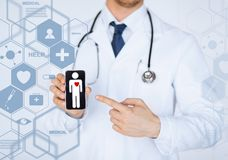 Male doctor with stethoscope and virtual screen. Healthcare, medical and future technology concept - male doctor with stethoscope and virtual screen Stock Photos