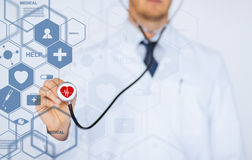 Male doctor with stethoscope and virtual screen. Healthcare, medical and future technology concept - male doctor with stethoscope and virtual screen Royalty Free Stock Images