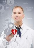 Male doctor with stethoscope and virtual screen Royalty Free Stock Photography