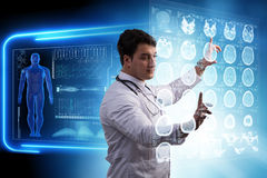 The male doctor studing x-ray image of mri scan Royalty Free Stock Photography