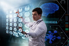 The male doctor studing x-ray image of mri scan Stock Images
