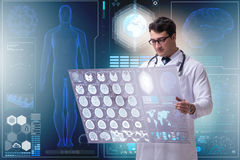 The male doctor studying results of brain mri scan Stock Photo