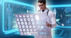 The male doctor studying results of brain mri scan Royalty Free Stock Image