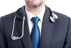 Male doctor with suit and stethoscope. Chest or torso pf hospital manager Stock Image