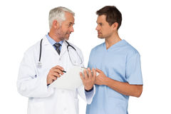 Male doctor and surgeon discussing reports Royalty Free Stock Image