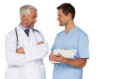 Male doctor and surgeon discussing reports Stock Photos