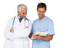 Male doctor and surgeon discussing reports Royalty Free Stock Photos