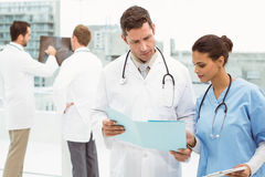 Male doctor and surgeon looking at reports Stock Photography