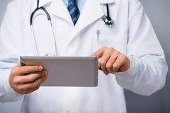 Male doctor with tablet computer Stock Images
