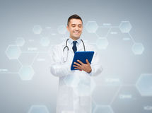 Male doctor with tablet pc and chemical formula Stock Photography